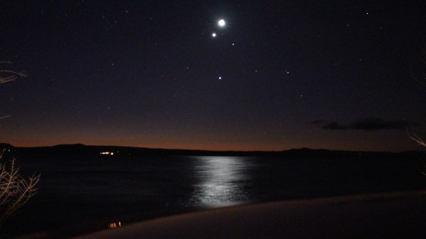 At lake Taupo. Taken about 15 mins after sunset on Sunday 19th July. That light below the moon is either Venus, Jupiter, or a comet... I keep hearing different explanations.